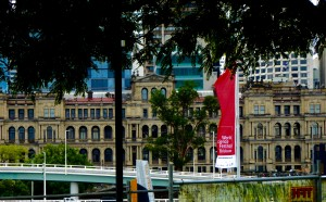 View of the old Treasury Building as seen from the South Bank of the River.   This building is now an operating casino (ironic, eh?).  Note the banner advertising the World Science Festival to be held soon in Brisbane, and the large newer office towers in the background.