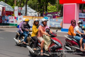 Motorbikes whiz along the streets of Saigon