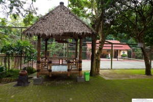 Tennis Court and Observation Area under a Thatched Roof in Java