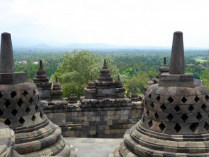 a view out from among the stupa near the top of Borobudur