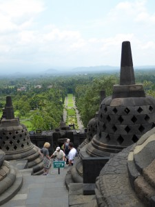 among the stupa approximately half-way up the steps to attain enlightenment; looking over the gardens