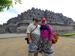 Joe and MA, in sarongs, in front of Borobudur (thirsty for beer!).