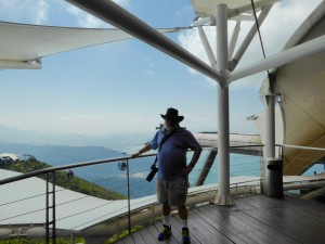 Joe at the top of the Mountain  - note a couple of cable cars working their way into his right hand