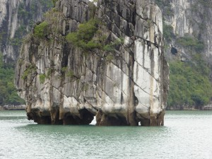 Ha Long Bay - close up of one of the limestone formations and its caves