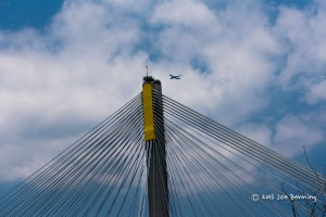 Plane flying over span bridge in Hong Kong