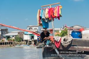 Trader Displays Her Wares in Floating Market of the Mekong River
