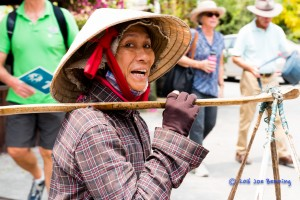 Woman Carries Goods  to Market in Hoi An