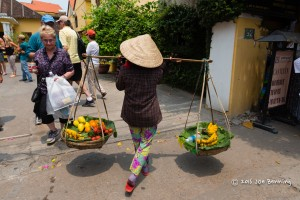 Woman Carries Produce to Market in Hoi An