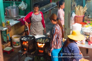 Woman cooking meals in open market in Cambodia