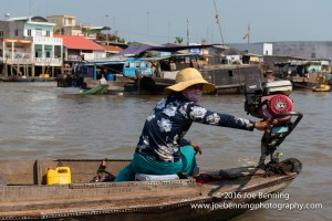 Vietnamese Woman Navigating the Mekong River