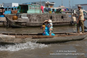 Woman with Baby in Vietnamese Junk on Mekong River