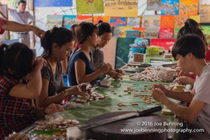 Workers making coconut candy in a village workshop along the Mekong River