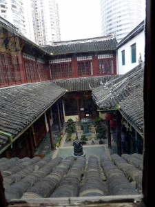 interior courtyard of the temple; note the clay roof tiles and the high rise buildings in the background - this temple is surrounded by buildings and construction