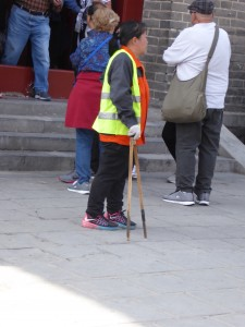 a maintenance lady at the Great Wall - I thought her tool looked like chopsticks
