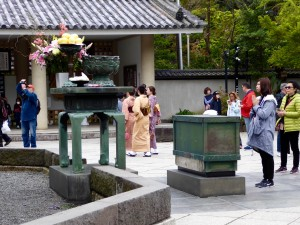 At Kamakura (outside Tokyo) we saw the Great Buddha, and young ladies in traditional dress who joined others worshipping before Buddha