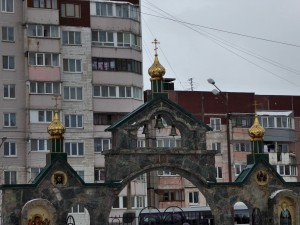 Entry to the Orthodox Church; note the fairly new housing in the background, which is showing signs of wear already