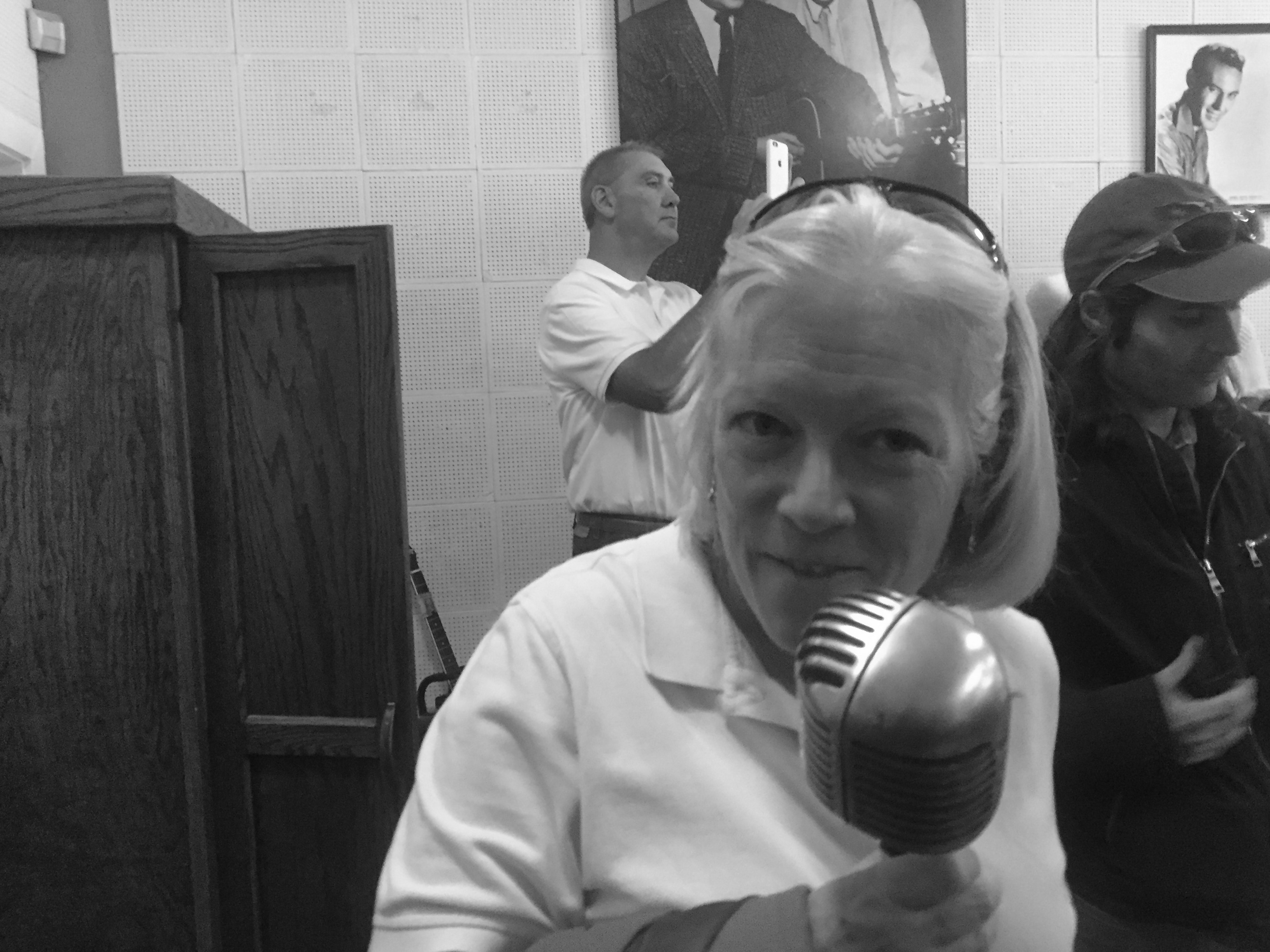 Mary Anne at a microphone used by Elvis in the early years.